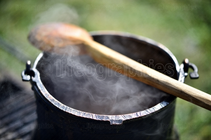 Pot with hot food outdoor
