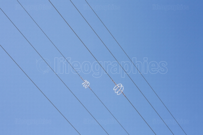 Power line wires over blue sky
