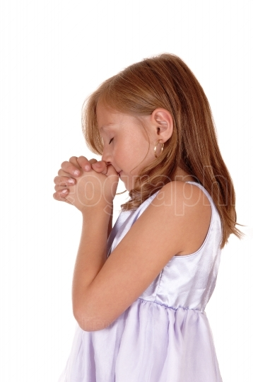 Praying young girl