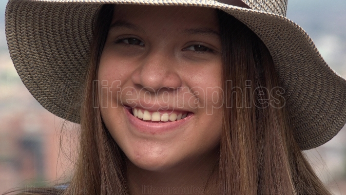 Pretty Face Of Teen Girl Smiling