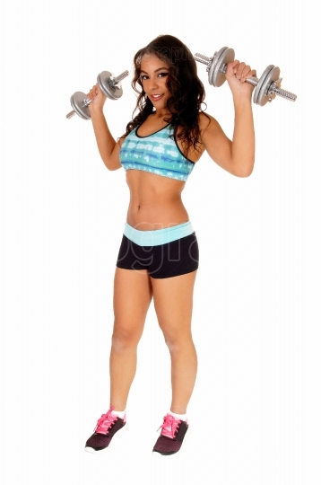 Pretty woman lifting dumbbell s