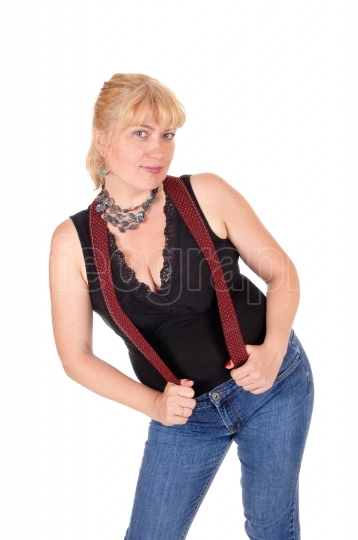 Pretty woman standing with suspenders.