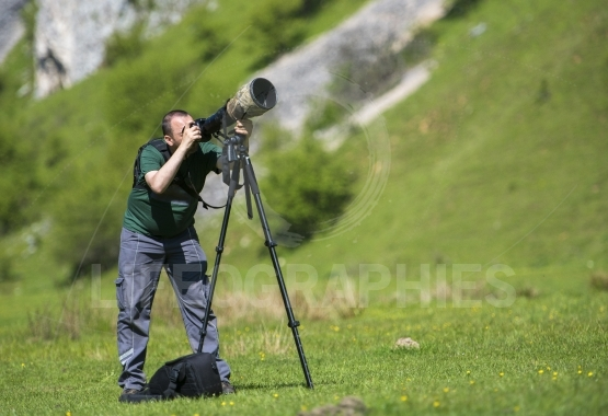 Professional travel on location and nature videographer/photographer (man) photographing and video nature and landscape outdoor.