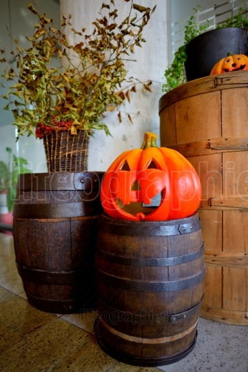 Pumpkins on old barrel