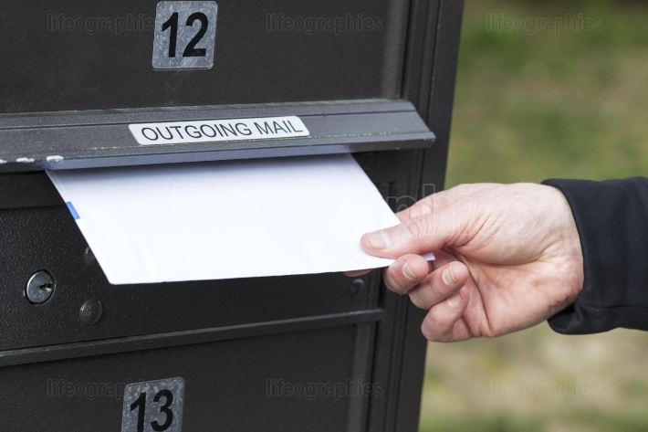Putting Letter in Outgoing Postal Mailbox