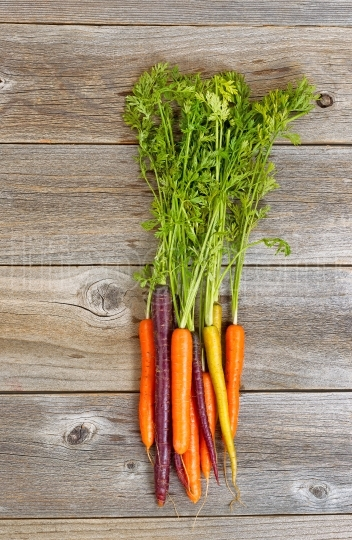 Rainbow carrots on rustic wooden boards