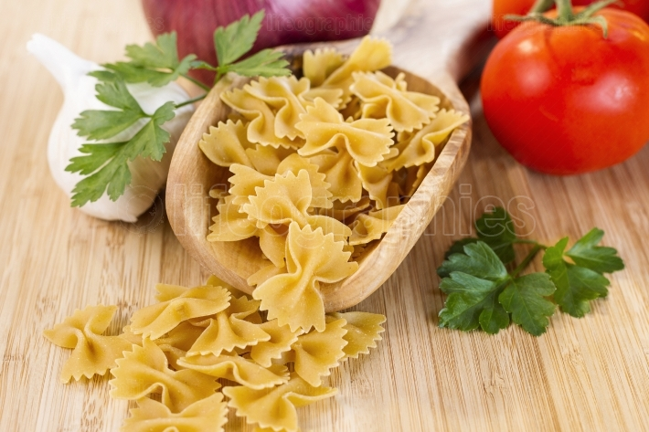 Raw Pasta with vegetables and herbs