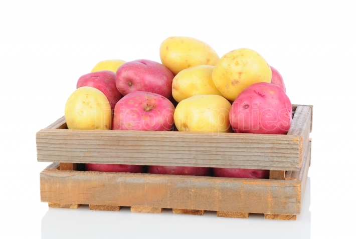 Red and White Potatoes in Wooden Crate