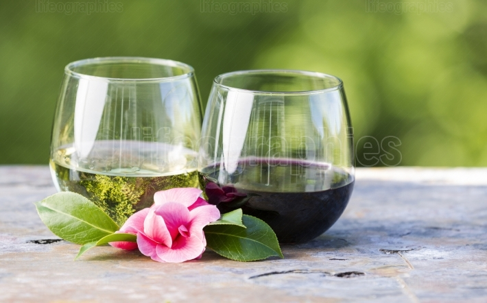 Red and White Wine with Pink Flower outdoors