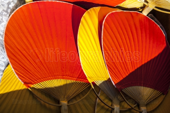 Red and yellow bamboo rigid fans