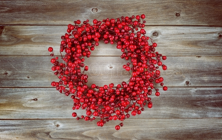 Red Berry Holiday Wreath on aged wood