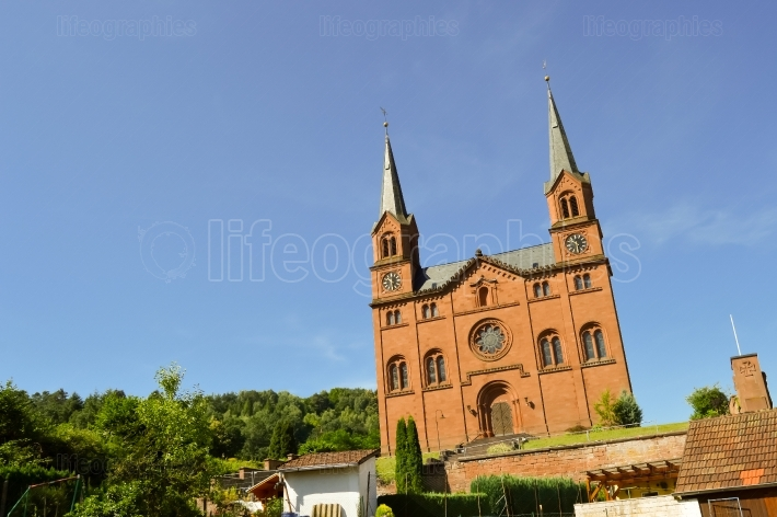 Red brick church with two steeples