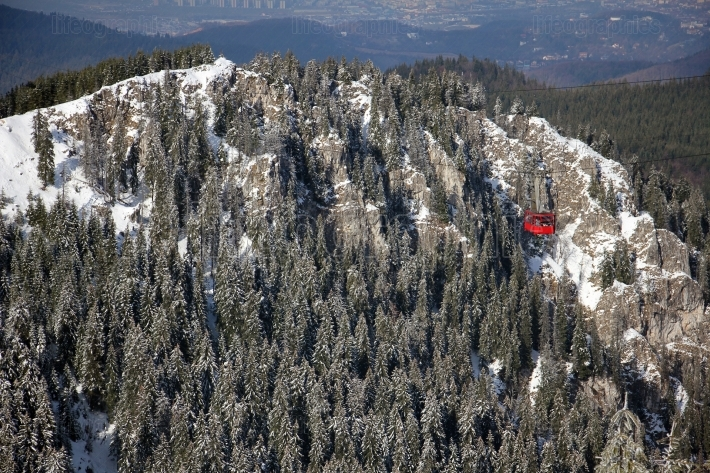 Red cable car in the mountains