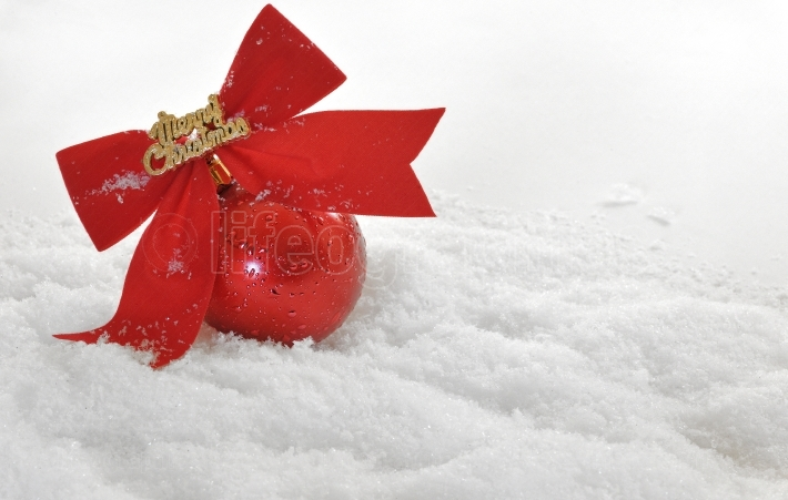 Red Christmas globe in snow
