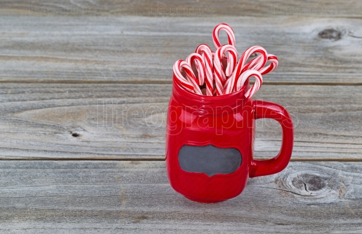 Red Cup filled with Candy Canes for the holiday season