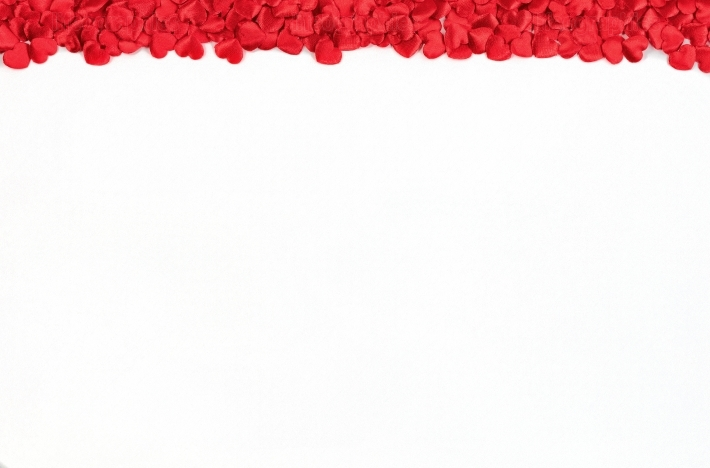 Red heart shapes border on white background