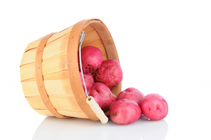 Red Potatoes Basket Spill on White