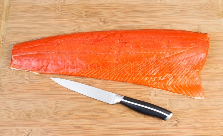 Red Salmon with Cutting Knife on Board