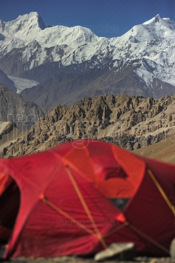 Red tent with mountains from karakoram range from Shimshal valley