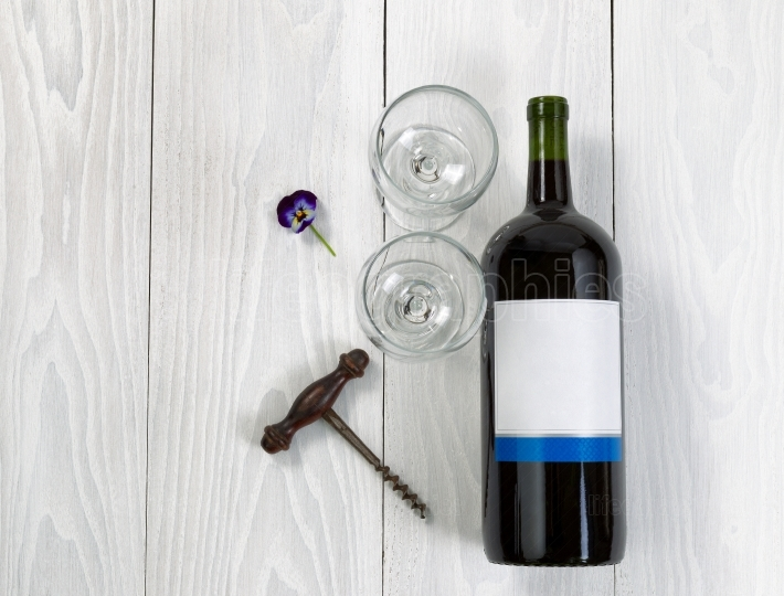 Red Wine bottle and glasses on white wooden board