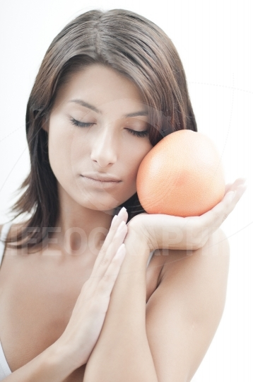 Relaxed girl with orange