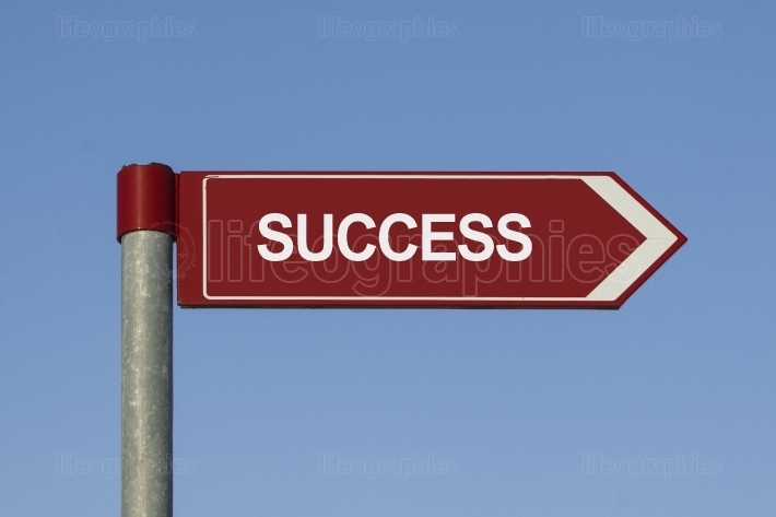 Road to success. Success text on sign post
