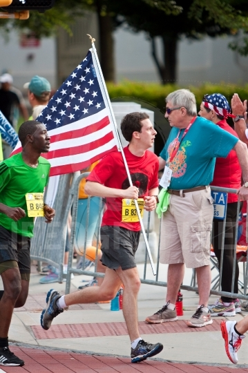 Runner Carries American Flag In July 4 Atlanta Road Race
