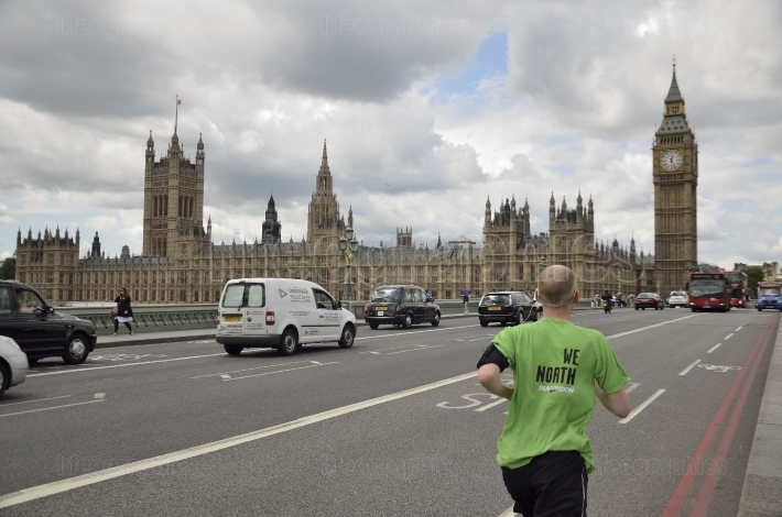 Runner in motion and big ben, the palace of westminster. the icons of england in vintage.