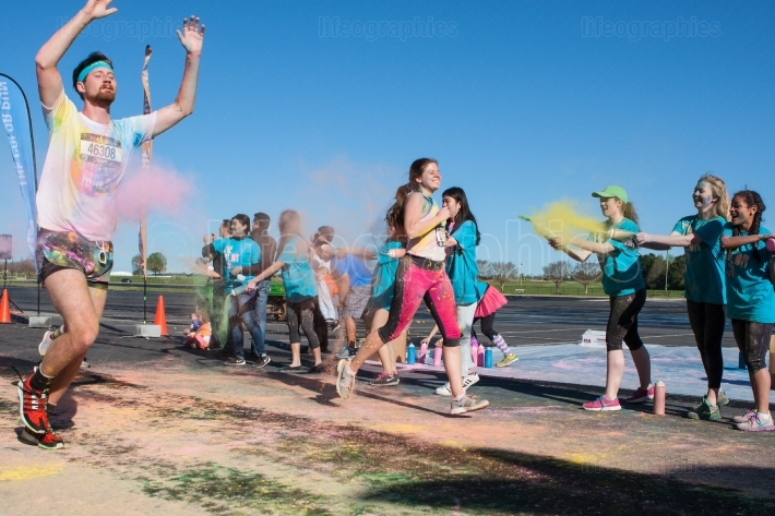 Runners are covered with colored corn starch at color run