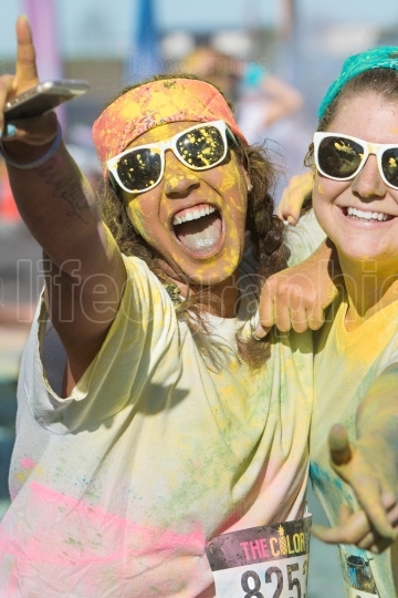 Runners Covered In Colored Corn Starch Celebrate Finishing Color