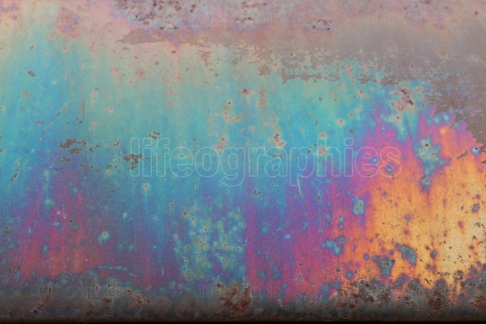 Rusted Metal On Junkyard Vehicle Creates Colorful Grunge Texture