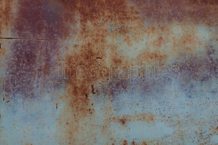 Rusted Metal On Junkyard Vehicle Creates Interesting Grunge Text
