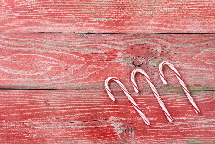 Rustic red wooden boards with Candy canes for Christmas decorati