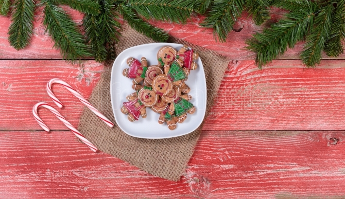 Rustic red wooden boards with Christmas cookies and candy canes