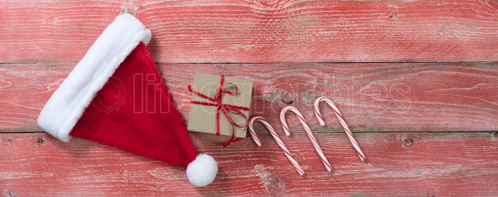 Rustic red wooden boards with gift and other Christmas decoratio