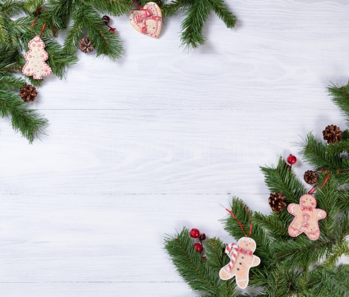 Rustic white wooden boards with Christmas decorations in corners