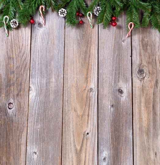 Rustic wooden boards with fir branches for Xmas concept