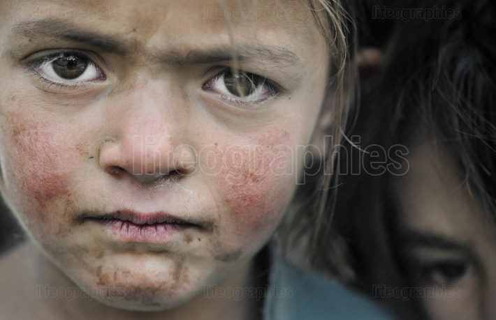 Sad face of a young kids from shimshal village