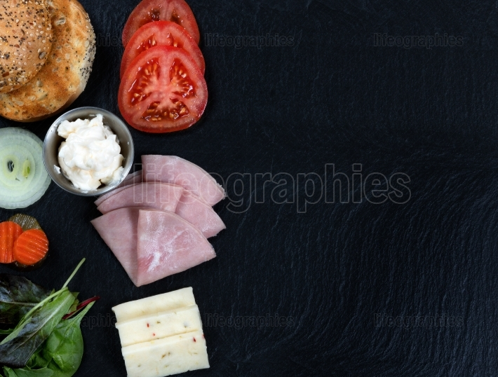 Sandwich ready to be made with fresh ingredients on slate stone
