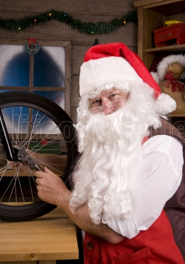Santa Assembling Bicycle in Workshop