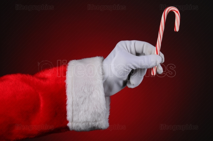 Santa Claus Hand Holding Candy Cane