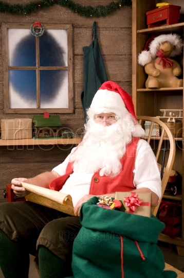 Santa Claus in Rocking Chair with Naughty List