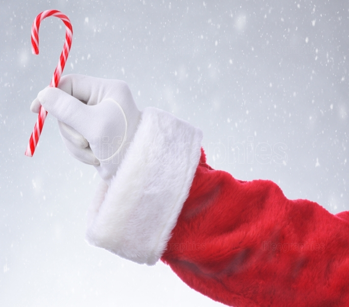 Santa Hanging Candy Cane Snowy Background