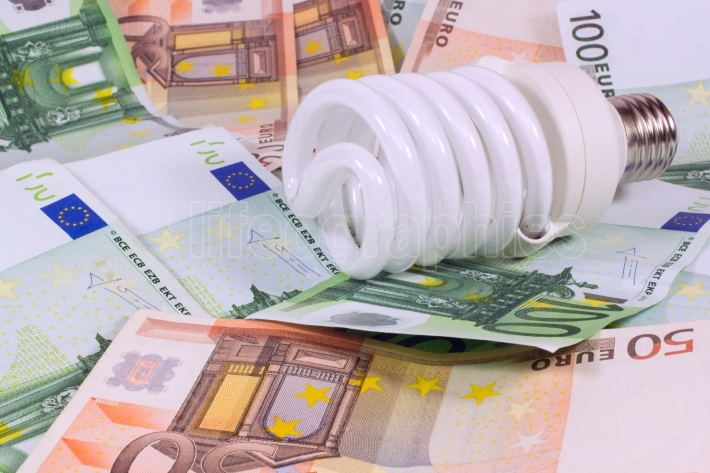 Saving money saving bulb.lightbulb on money euro background