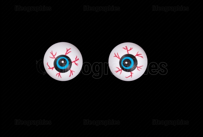 Scary eyeballs for Halloween isolated on black background