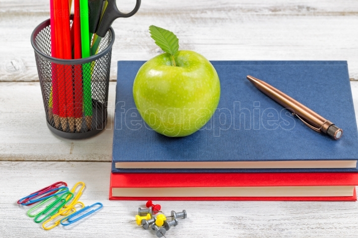 School supplies with textbooks on white desktop