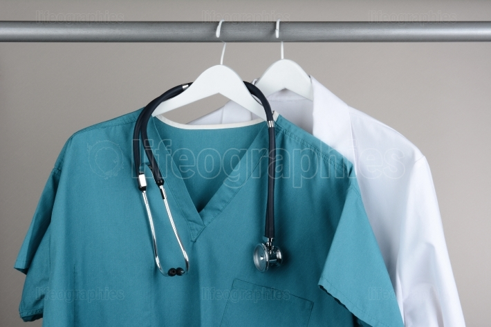 Scrubs with Stethoscope and Lab Coat on Hanger