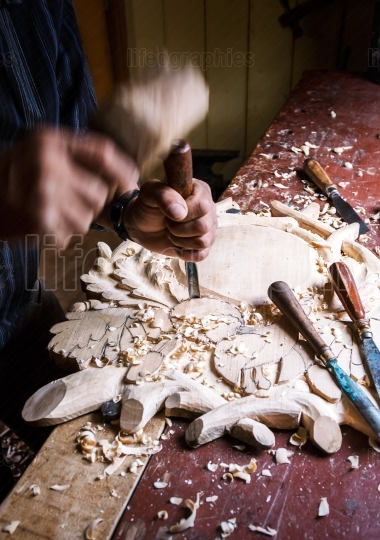 Sculptor wood worker in action