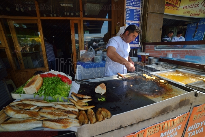 Seller of fish sandwiches at Istanbul. Istanbul street food.