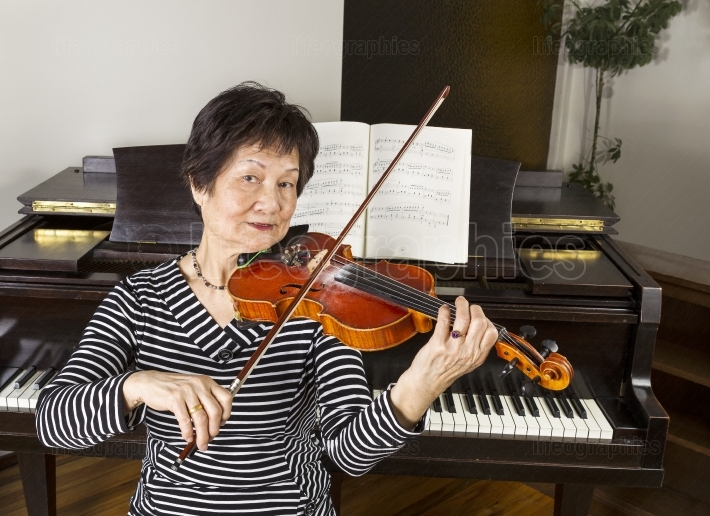 Senior Adult Women Playing the Violin